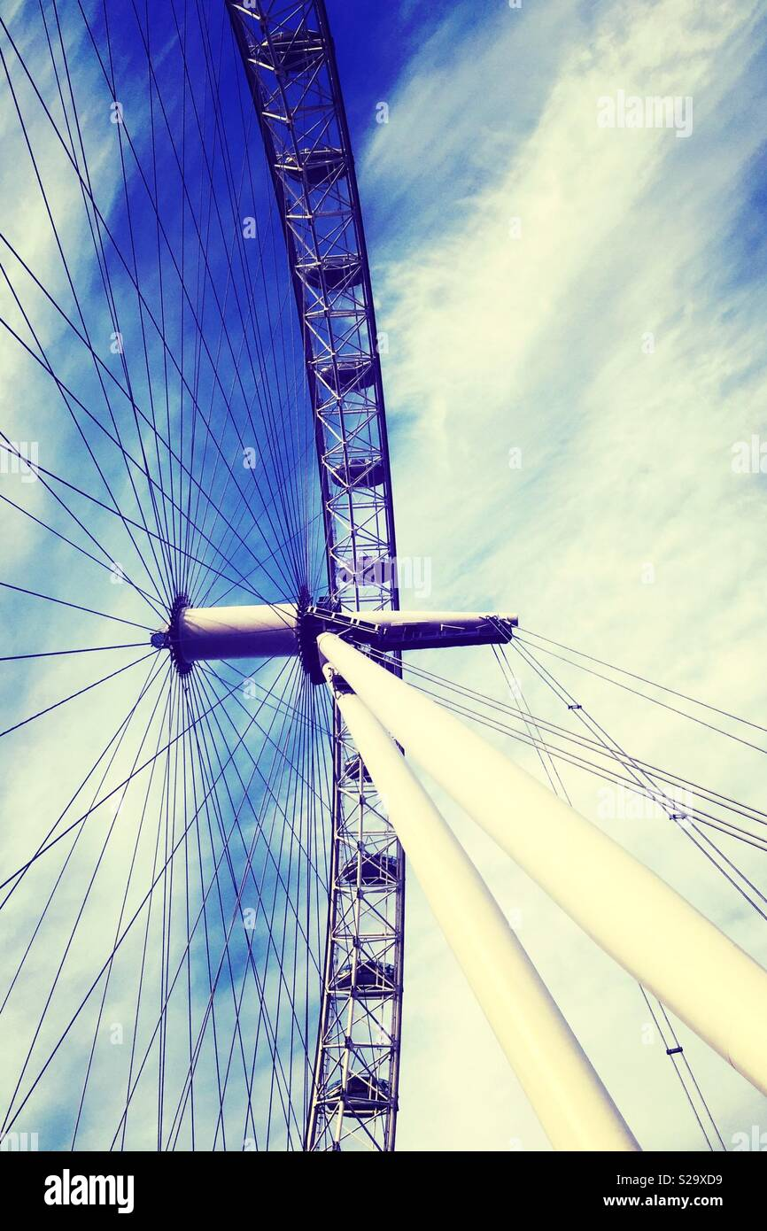 Close up of the London Eye looking up with blue sky - Stock Image