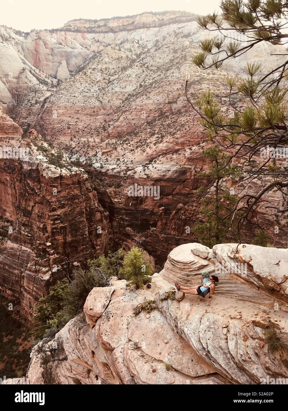 Woman on the edge in Zion National Park, UT - Stock Image