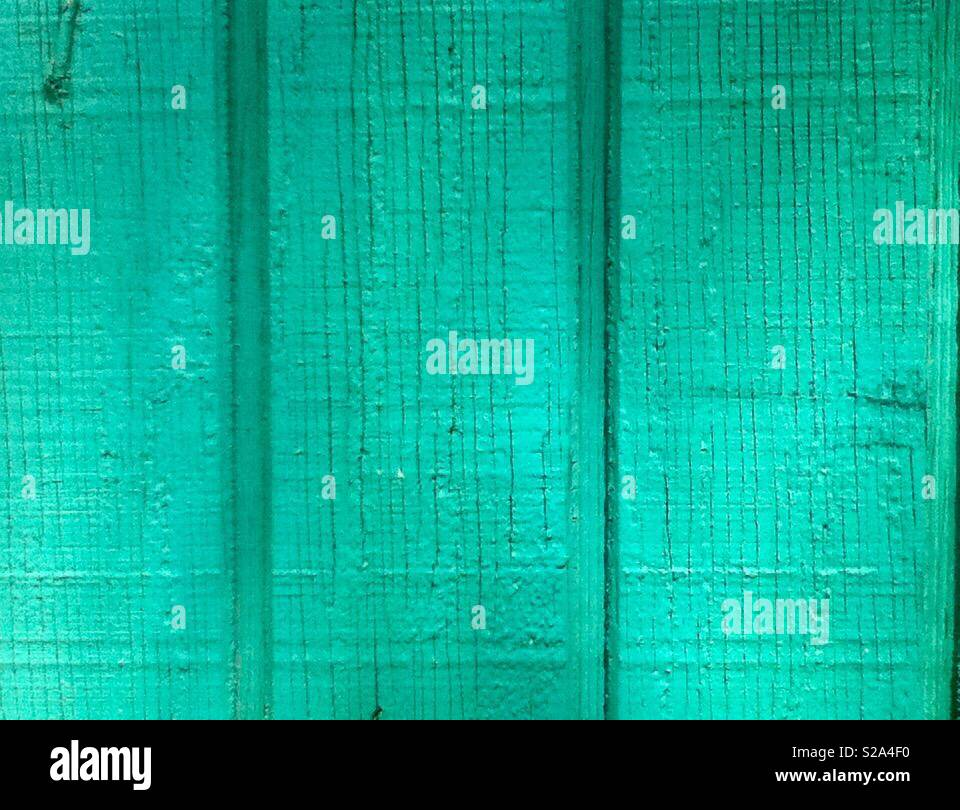 Close up of turquoise green wooden plank panels. - Stock Image
