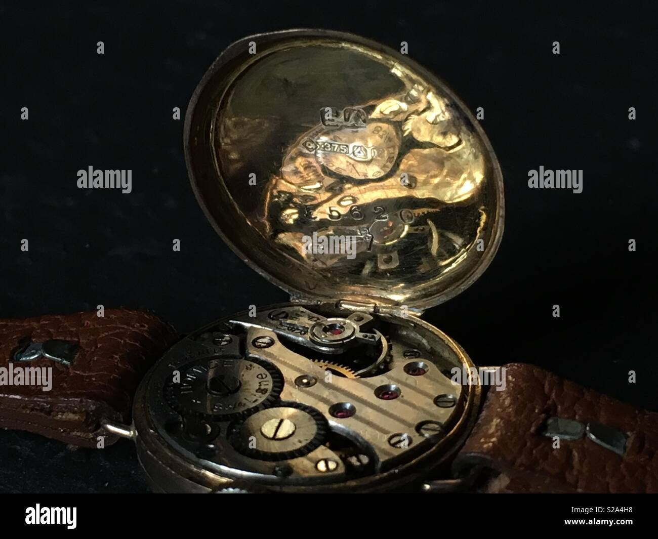 Vintage Mechanical watch movement in 9ct Yellow Gold Case close up - Stock Image