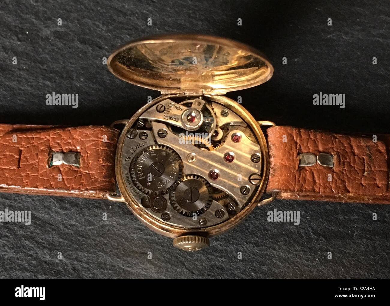 Vintage mechanical Wristwatch movement in 9ct Yellow Gold Case and leather strap close up - Stock Image