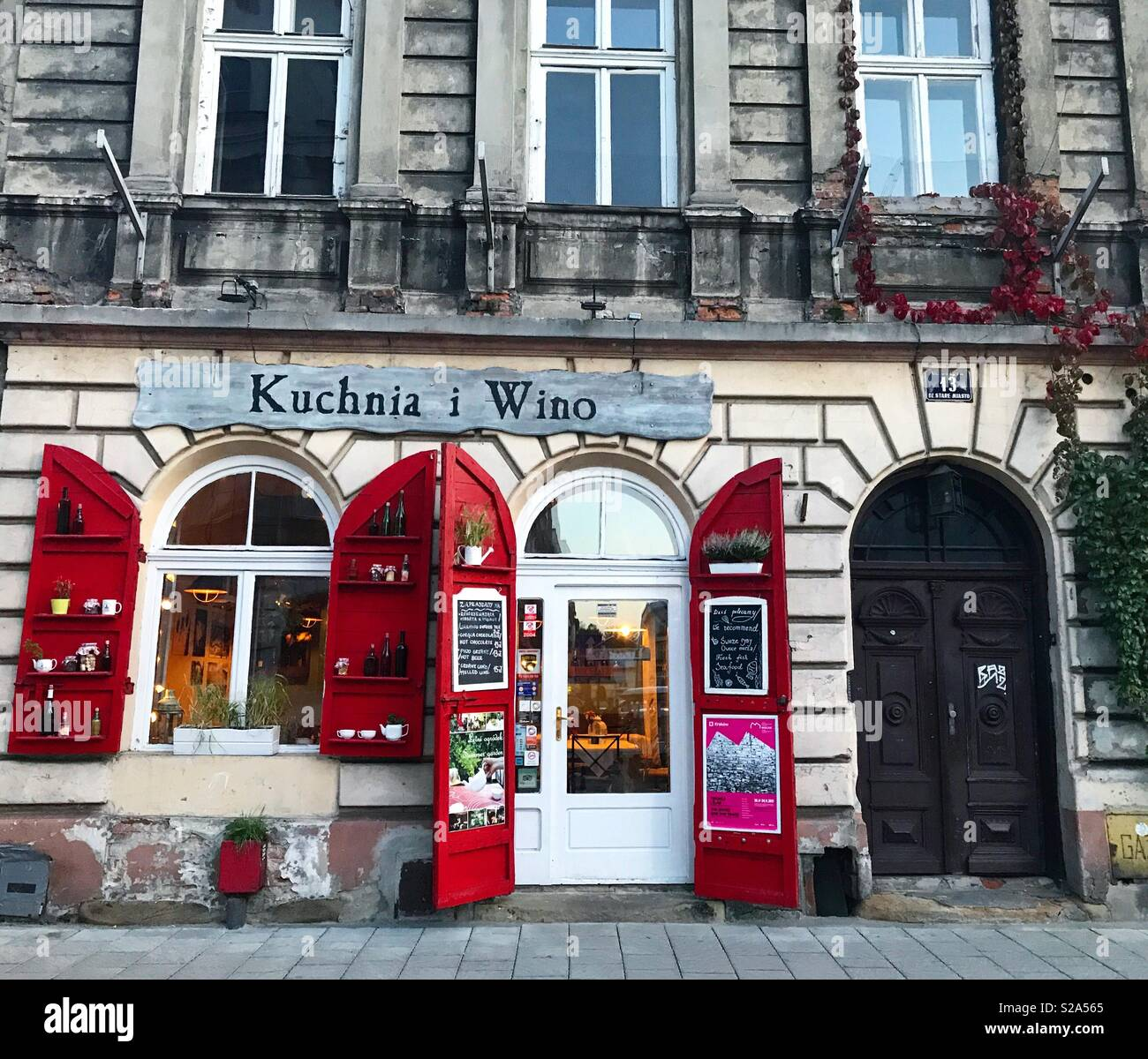 Red Window And Door Shutters On An Old Building In Kazimierz