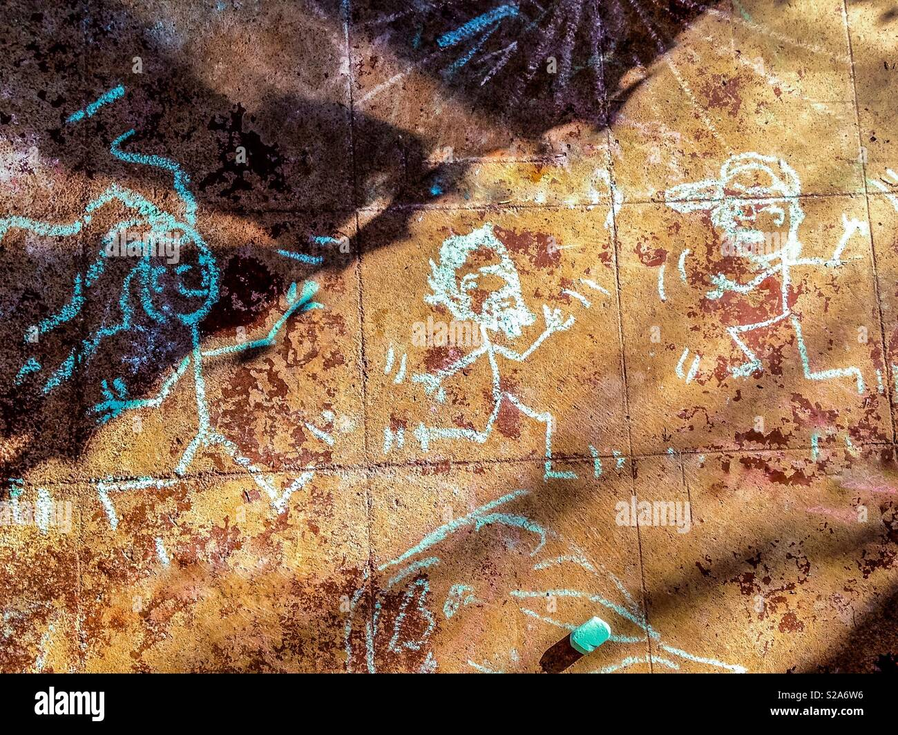 Dancing chalk stick figures drawn on front porch - Stock Image