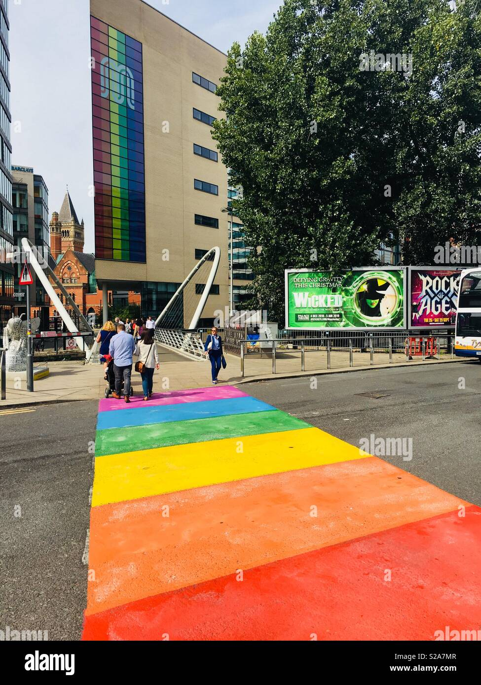 Pedestrian crossing repainted for a recent Manchester 'pride' event - Stock Image