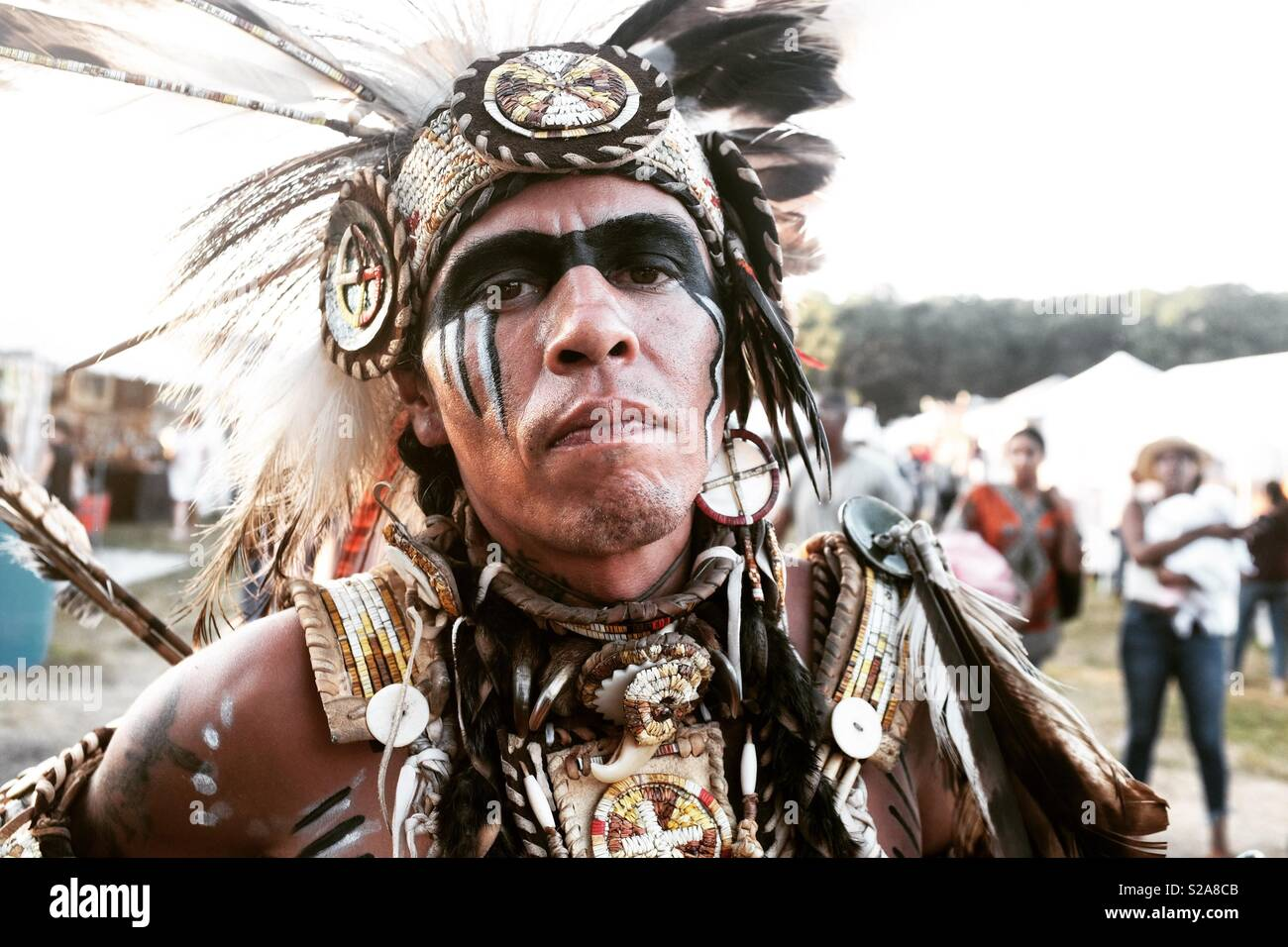 A Native American chieftain at the Shinnecock Pow Wow. - Stock Image