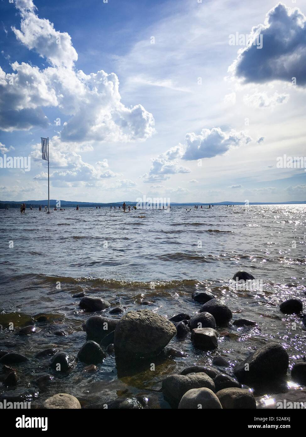 During this summers heatwave in Sweden the lakes become an important  resource enabling people to cool down. This is lake Siljan in Rättvik, Dalarna, Sweden. - Stock Image