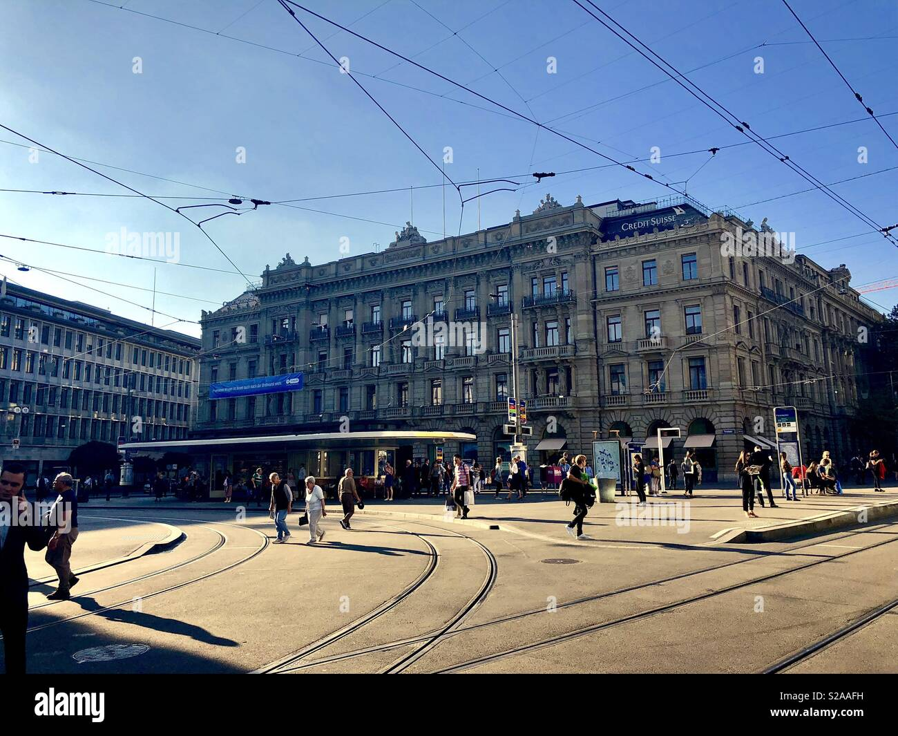 Paradeplatz with Buildings of UBS and Credit Suisse, and busy Tram Station, Zurich, Switzerland, Europe - Stock Image