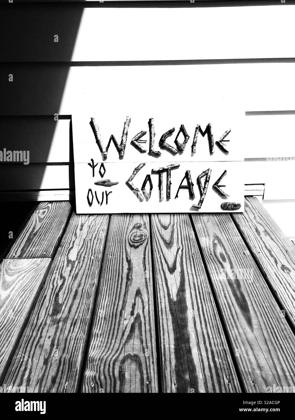 Welcome To Our Cottage sign - Stock Image