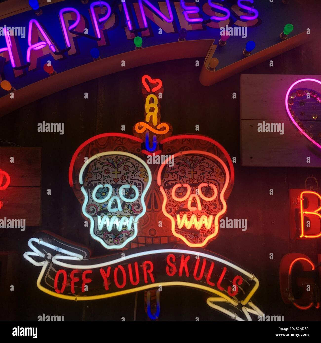 Off your skulls neon sign. - Stock Image