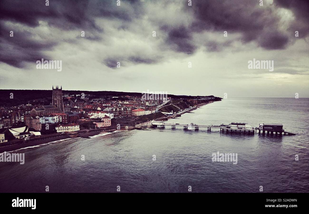 Aerial photo of Cromer, Norfolk including the pier and church from out to sea - Stock Image