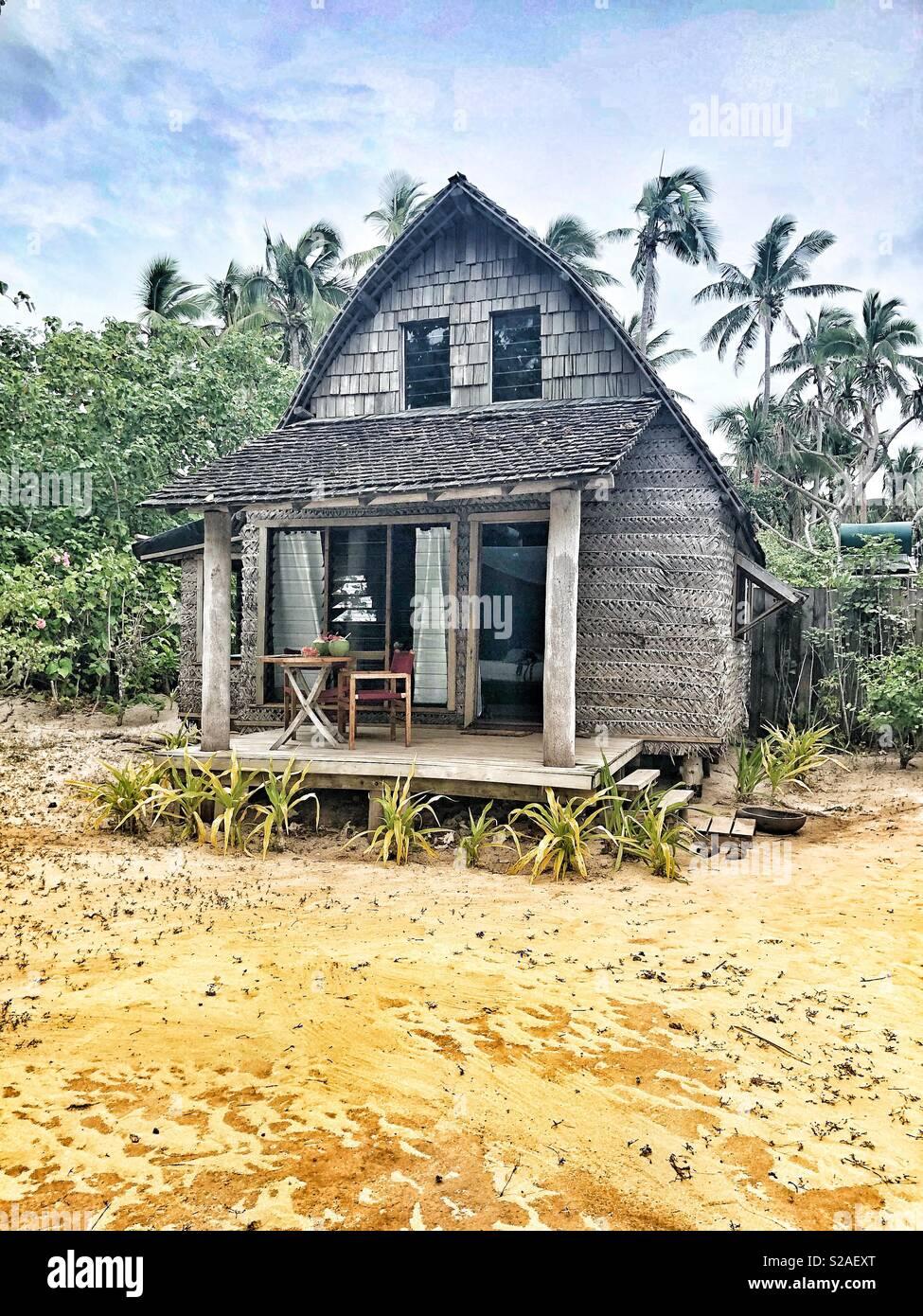 A Tongan Fale on the beach at Fafa Island Resort Stock Photo