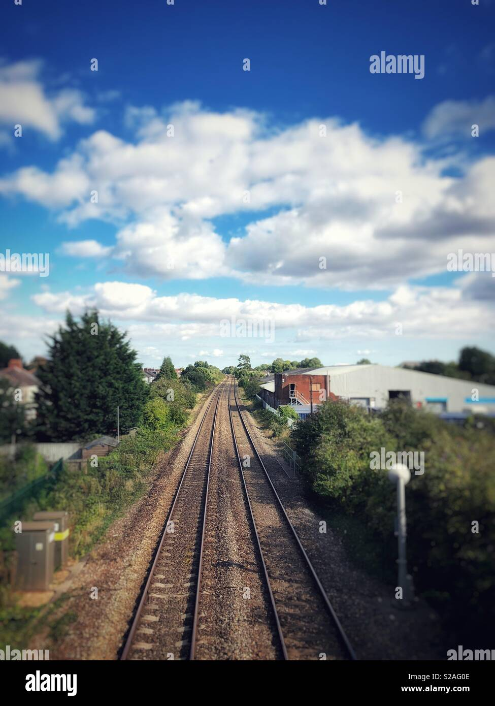Train line vanishing into the distance, on a sunny September day, Cardiff. - Stock Image