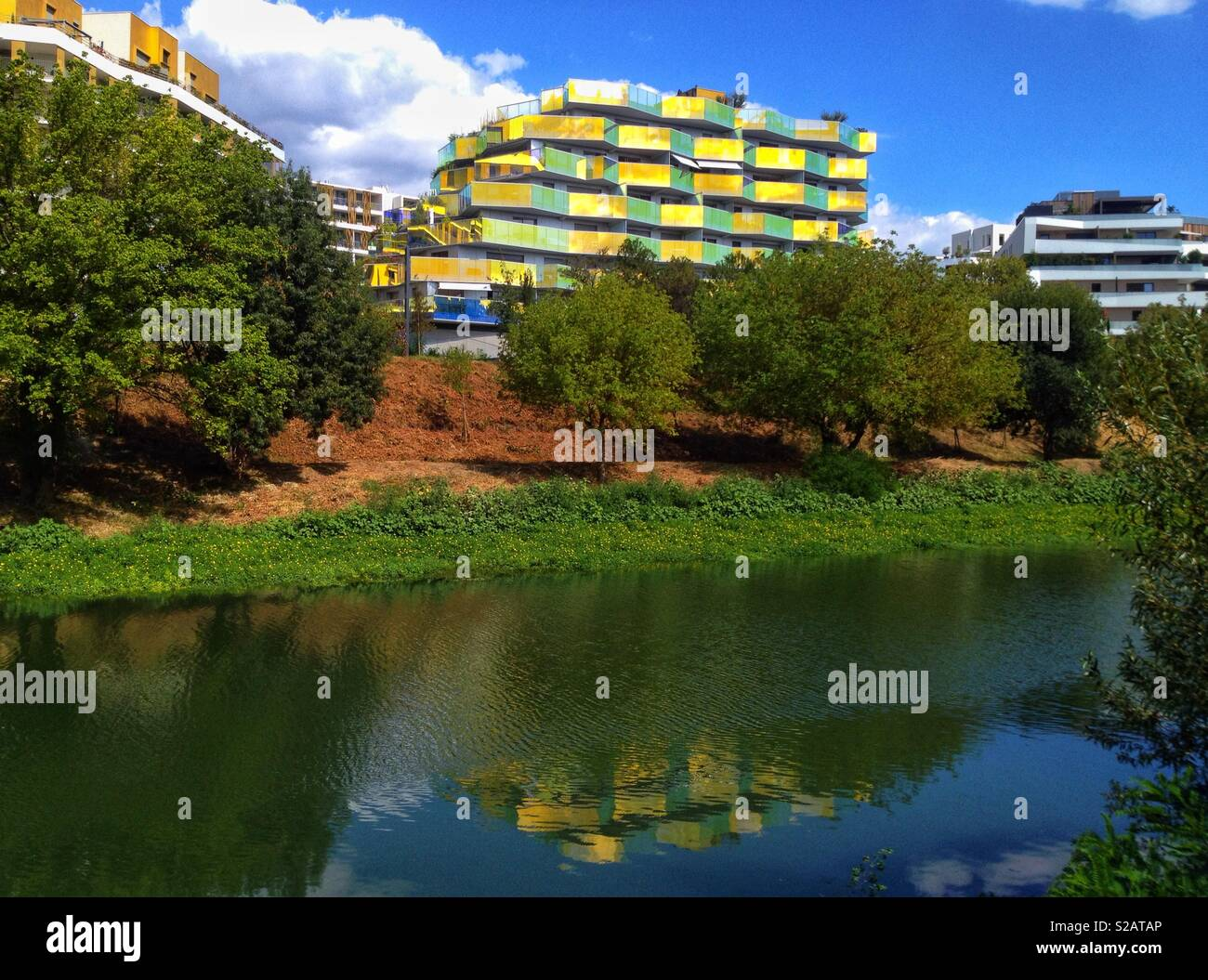Reflection of the new modern building Koh-I-Noor in the river Lez, Montpellier France - Stock Image