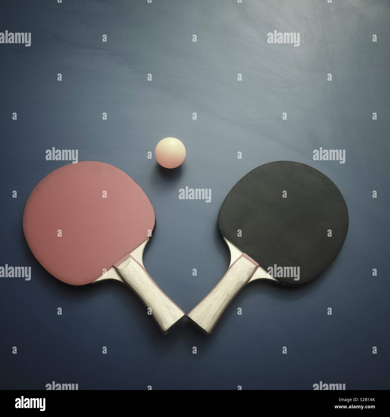 Creative photography of ping pong paddles and ball - Stock Image