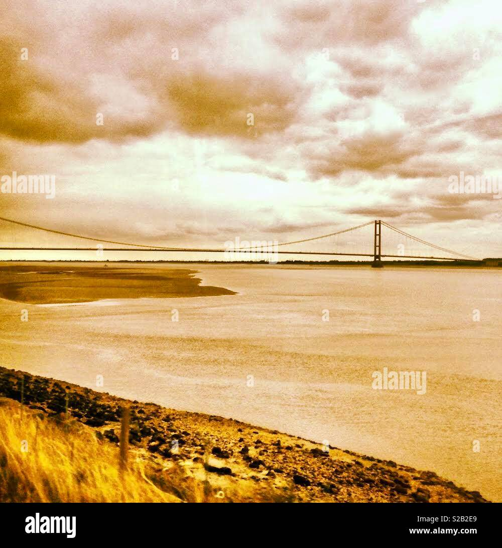 The River Humber and Humber bridge in Sepia tones - Stock Image