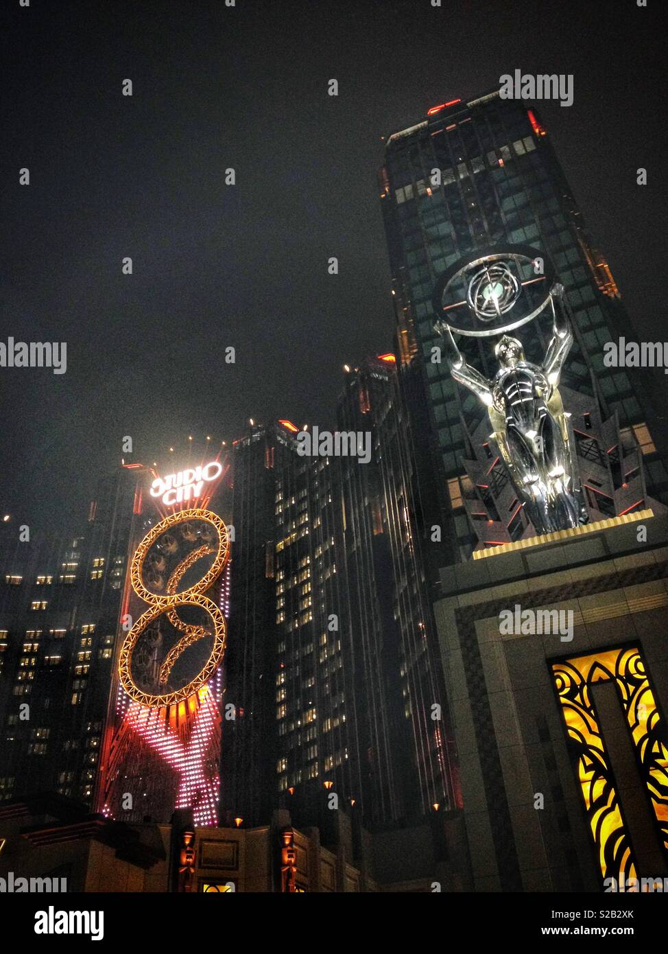 Studio City hotel, casino and shopping complex, Macau, featuring the Golden Reel, the world's first figure-8 ferris wheel. 8 is a lucky number in Chinese culture. - Stock Image