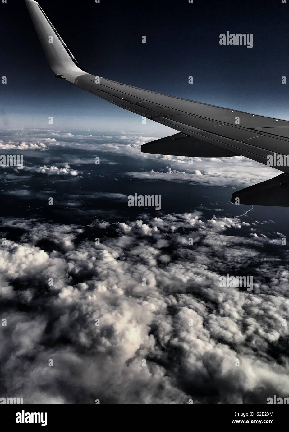 Flying above the clouds - Stock Image