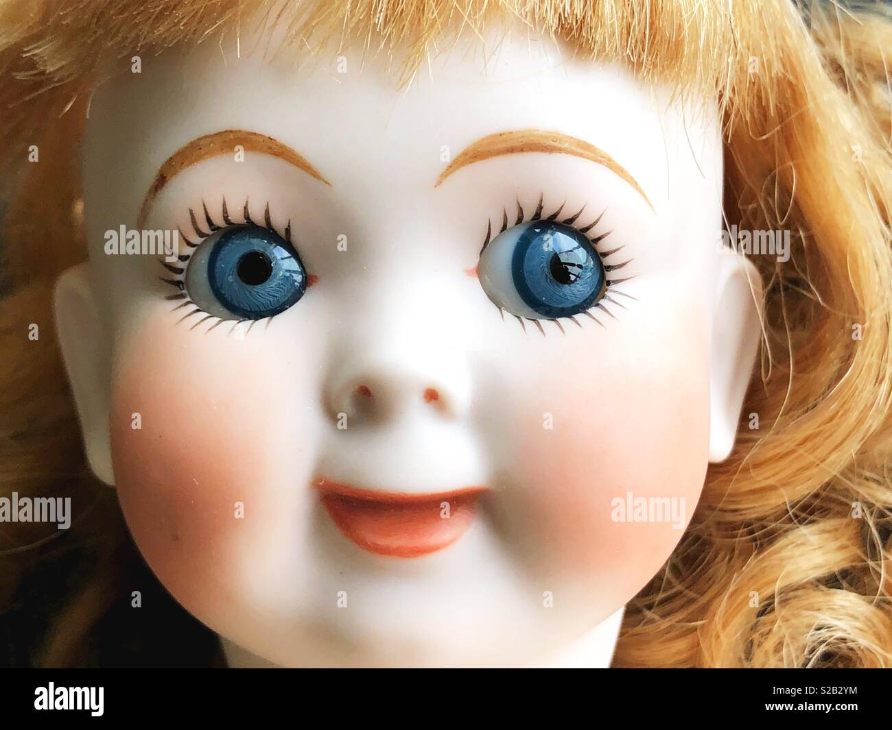 Close up of doll face. - Stock Image