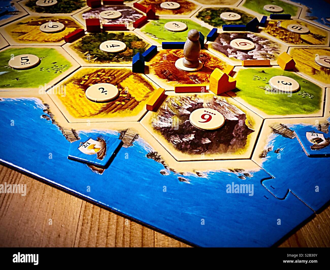 Settlers Of Catan Board Game On A Wood Table Stock Photo 311259787