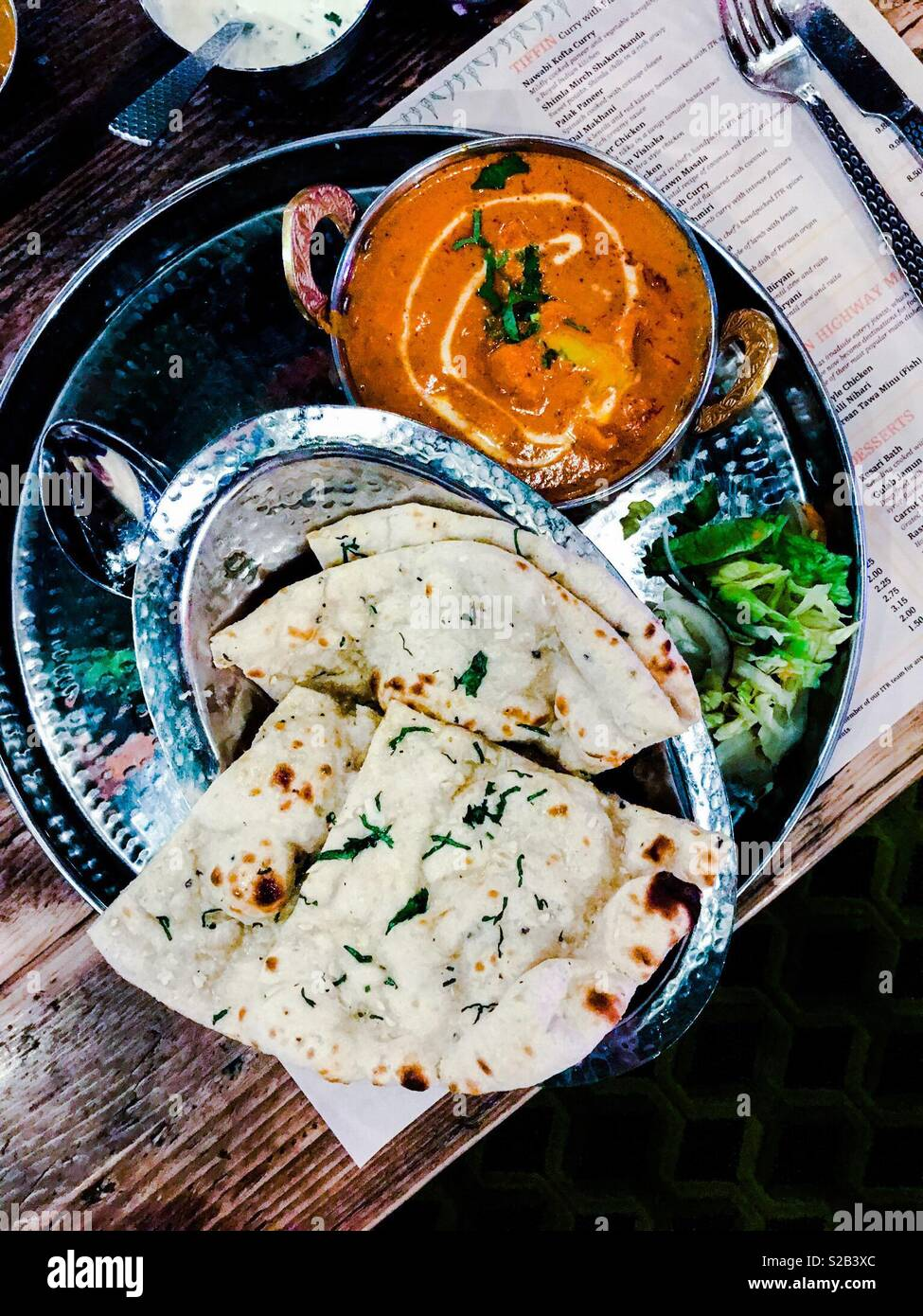 Southern Indian Butter Chicken Curry With Garlic Naan Bread On Silver Platter Stock Photo Alamy