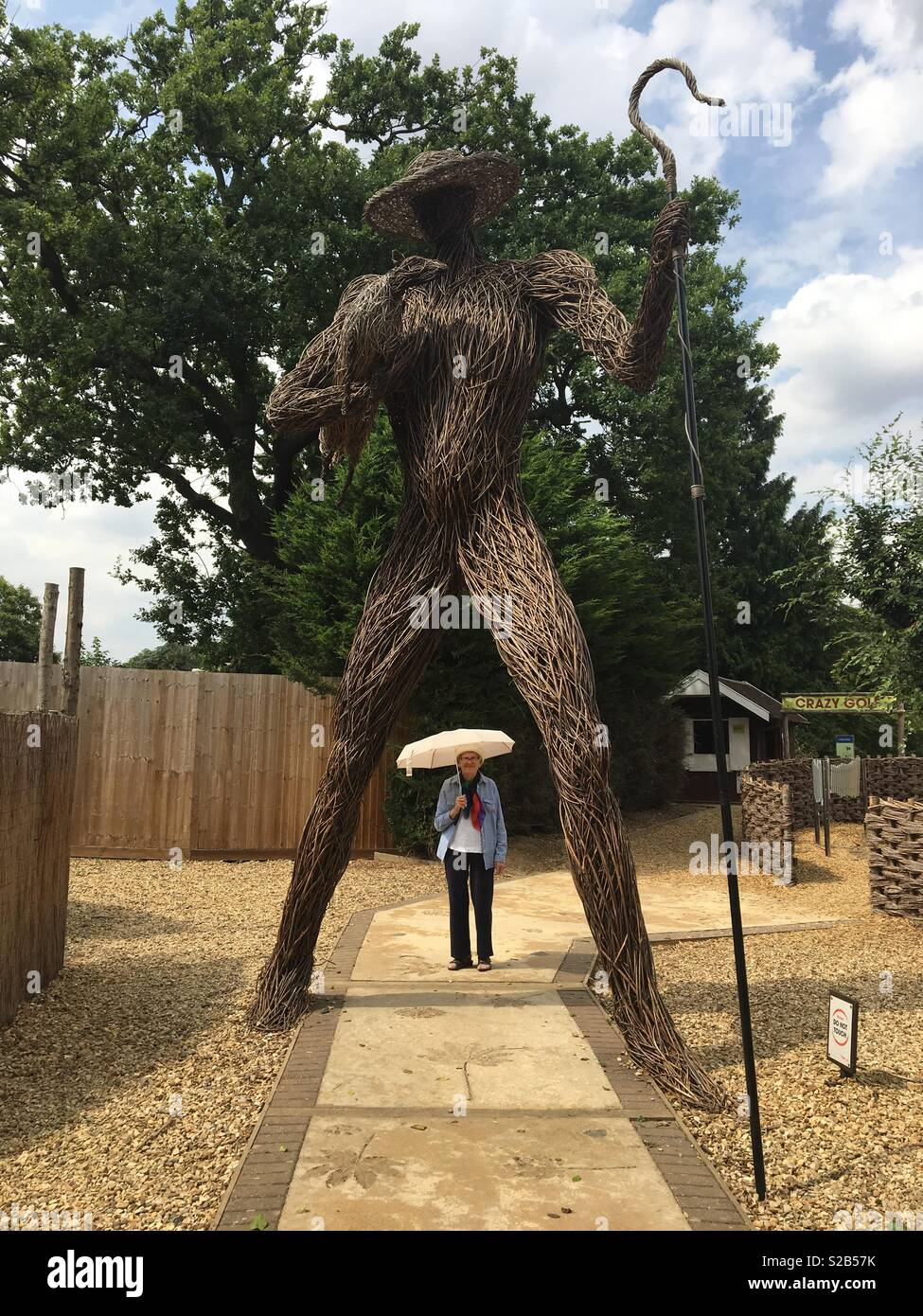 Dwarfed by the Wicker Man at Wicksteed Park Kettering - Stock Image