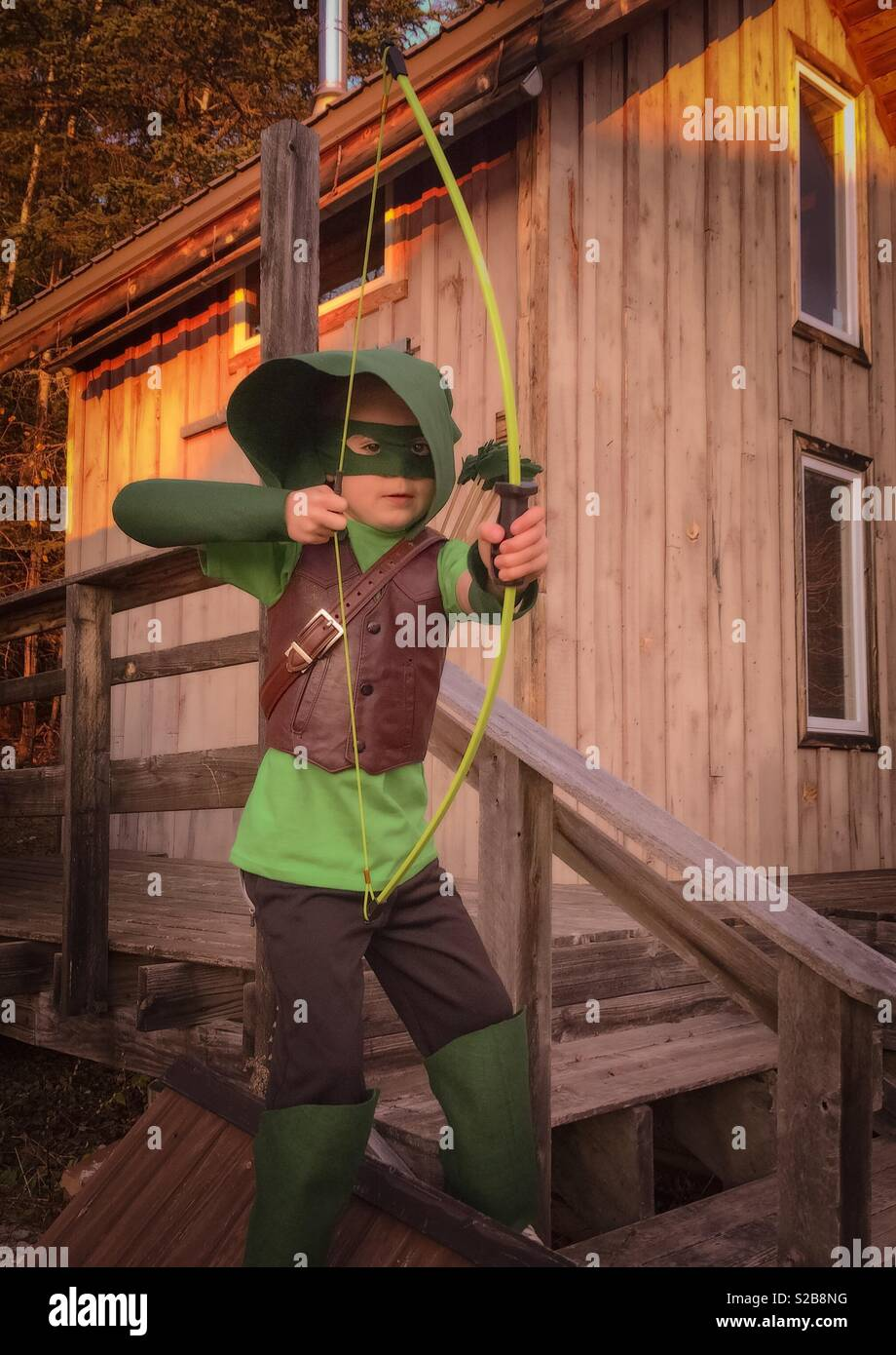 A Seven Year Old Boy Poses In His Green Arrow Costume On Halloween Stock Photo Alamy