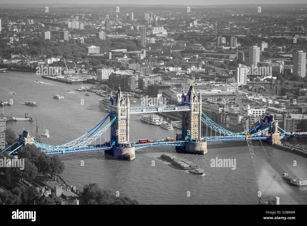 Black and white with pop of colour edit of tower bridge view from the sky garden river thames boats city