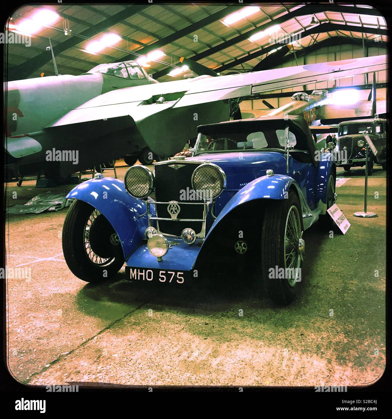 A 1954 MG TA Cochrane Special displayed next to a de Havilland Mosquito NFII aircraft. Lincolnshire Aviation Heritage Centre, East Kirkby, Lincolnshire, UK. - Stock Image