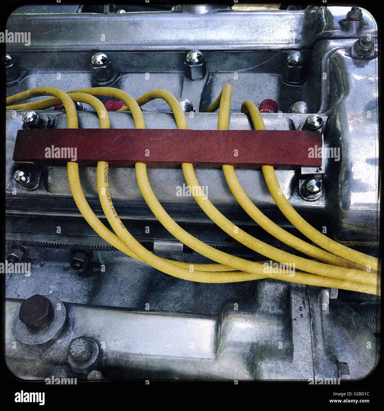 Clic engine and yellow spark plug wires Stock Photo ... on