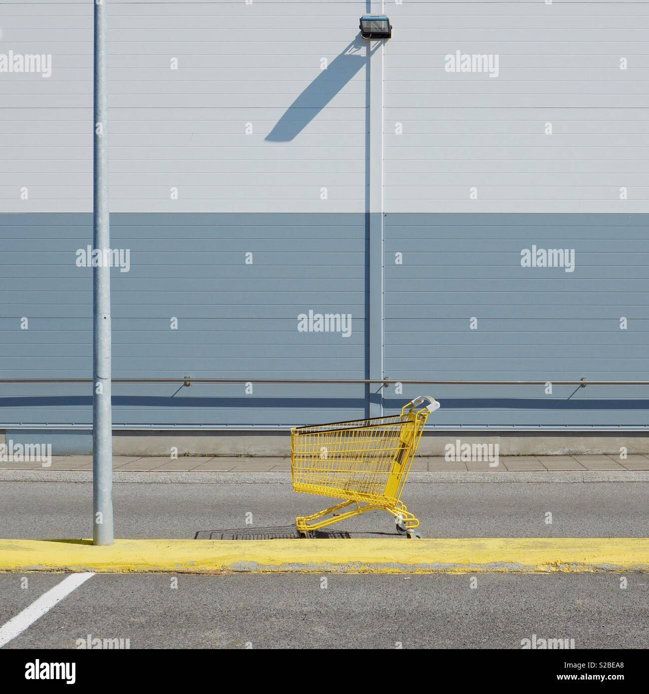 Yellow shopping trolley - Stock Image