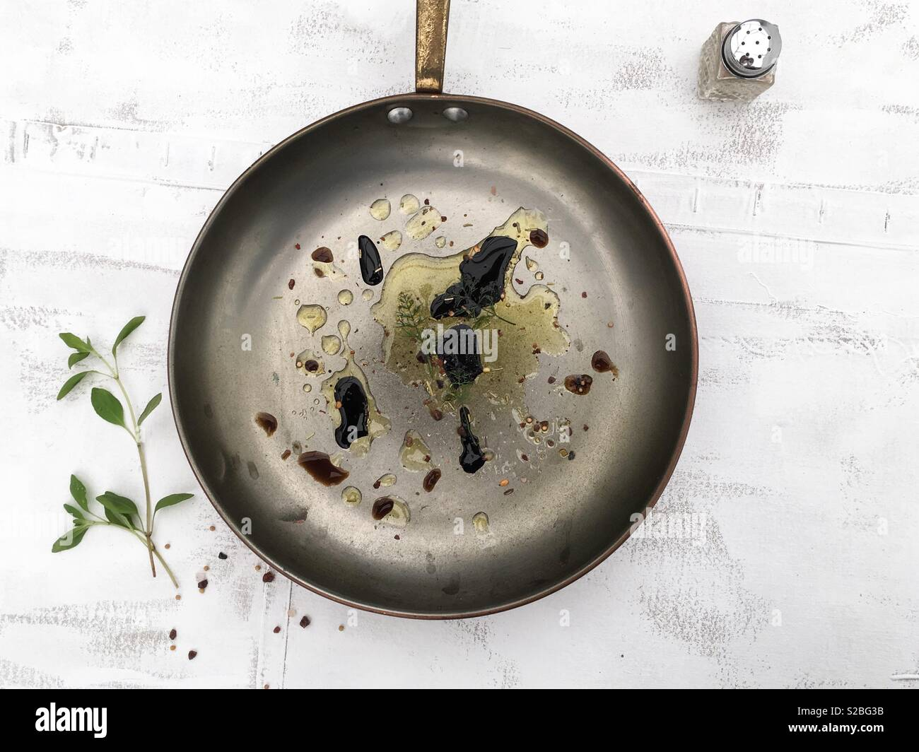 Basic Cooking with Olive Oil and Soy Souse in Frying Pan on White Rustic Background - Stock Image