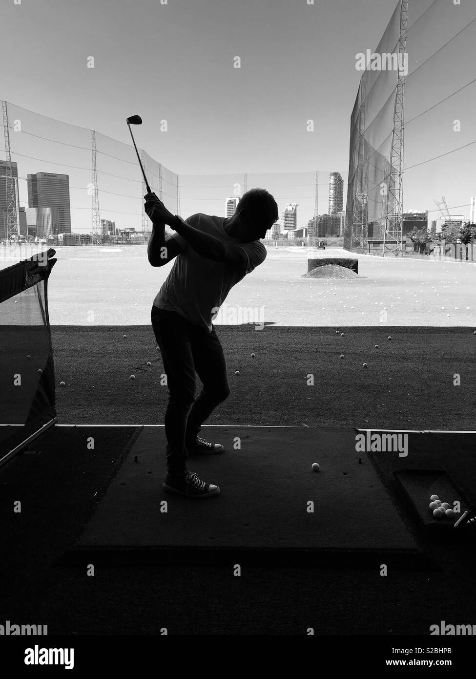 Backswing at the driving range in London - Stock Image