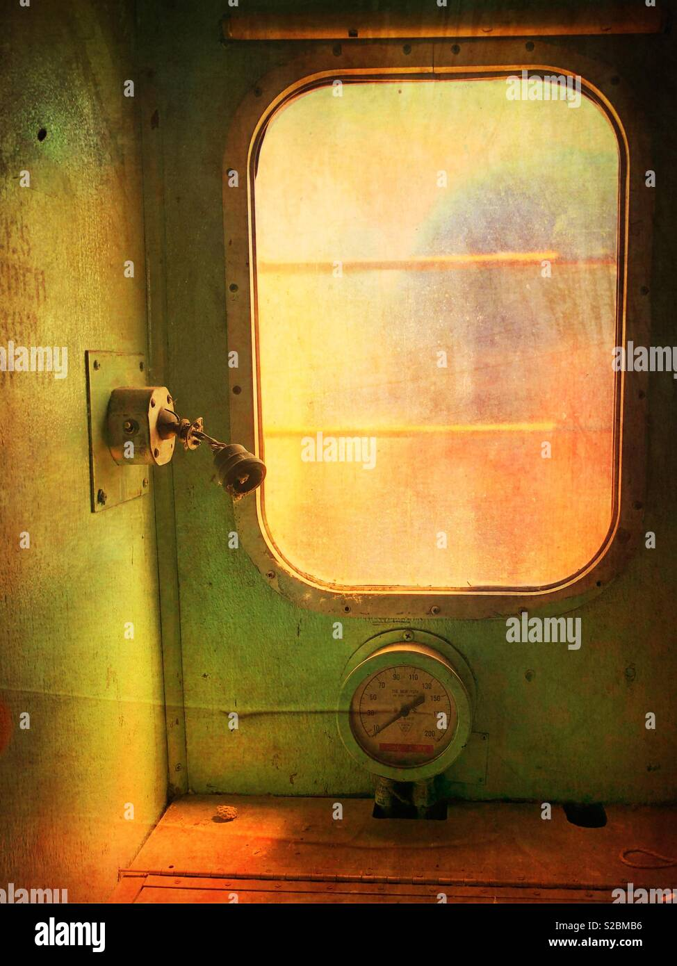 Window in an old abandoned train car. - Stock Image