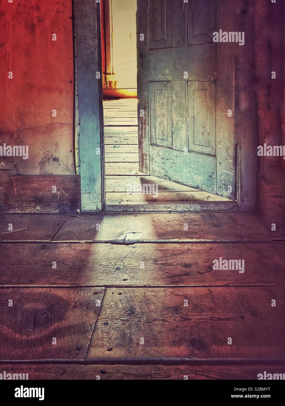 Open door in abandoned house. - Stock Image
