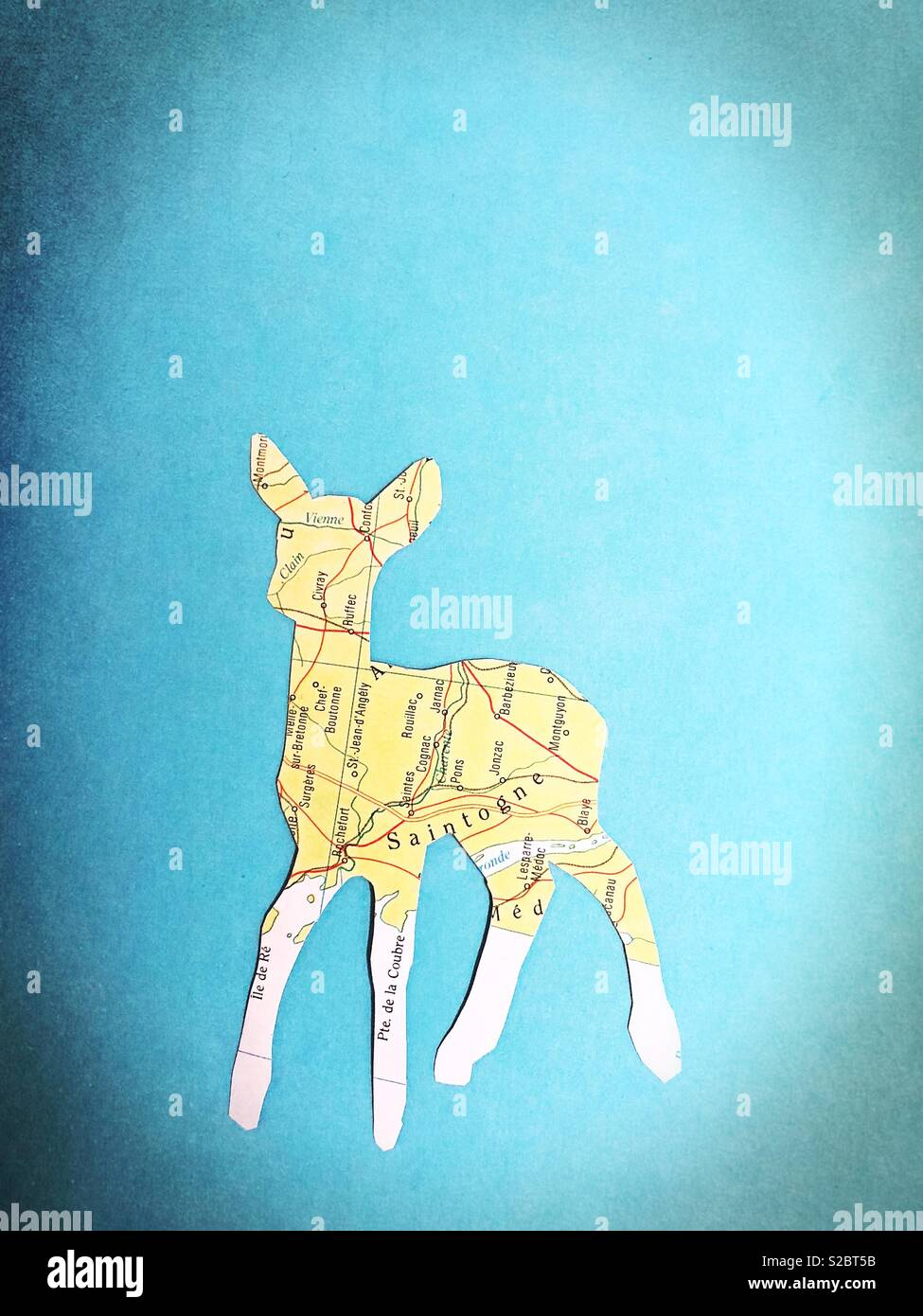 A fawn cutout made from a map. - Stock Image