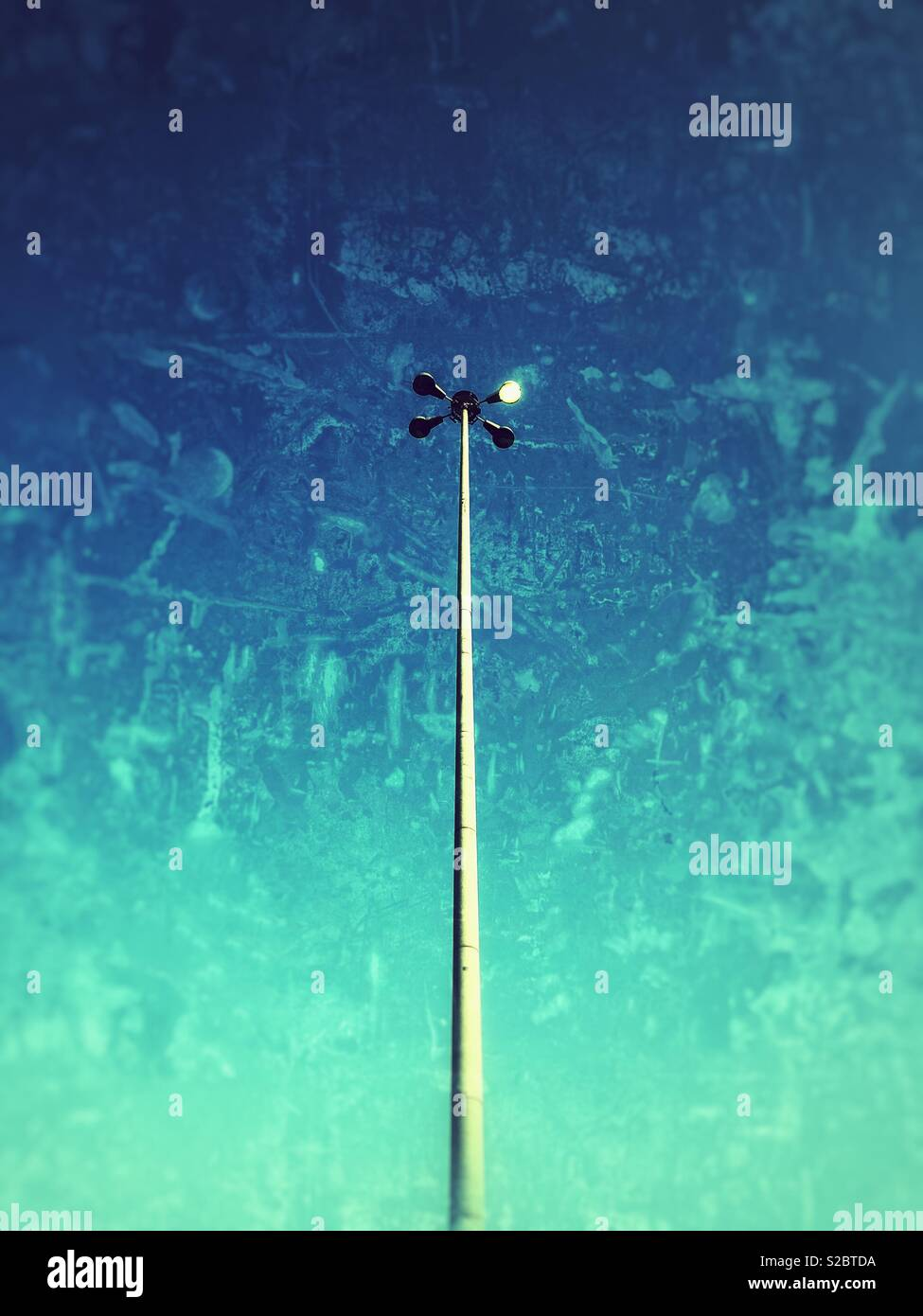 Light pole with grunge effect. - Stock Image