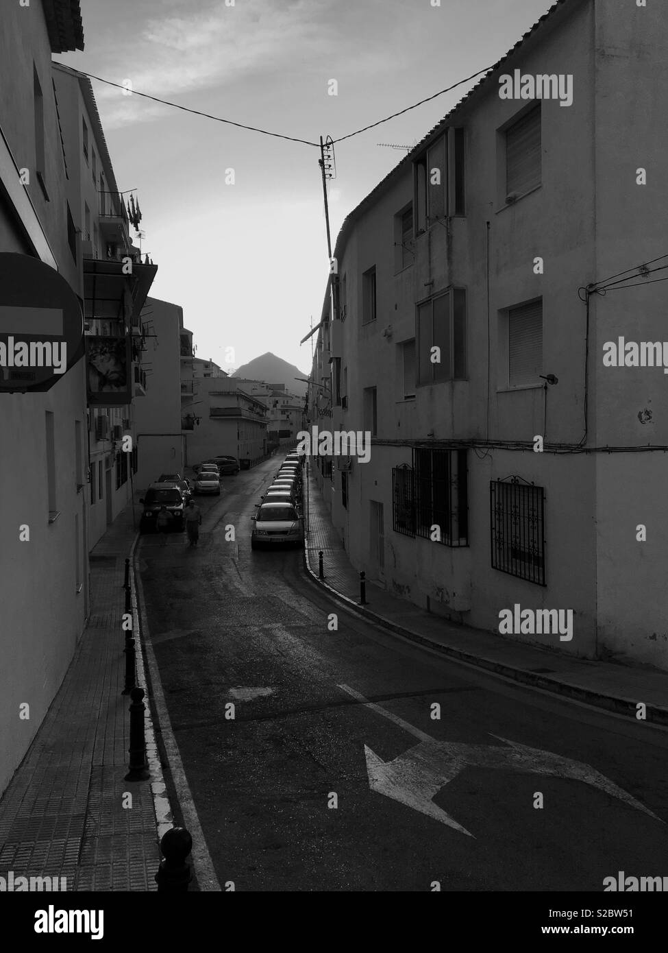 Street with parked Cars in the Town of Altea, Costa Blanca Spain. Black and White. - Stock Image