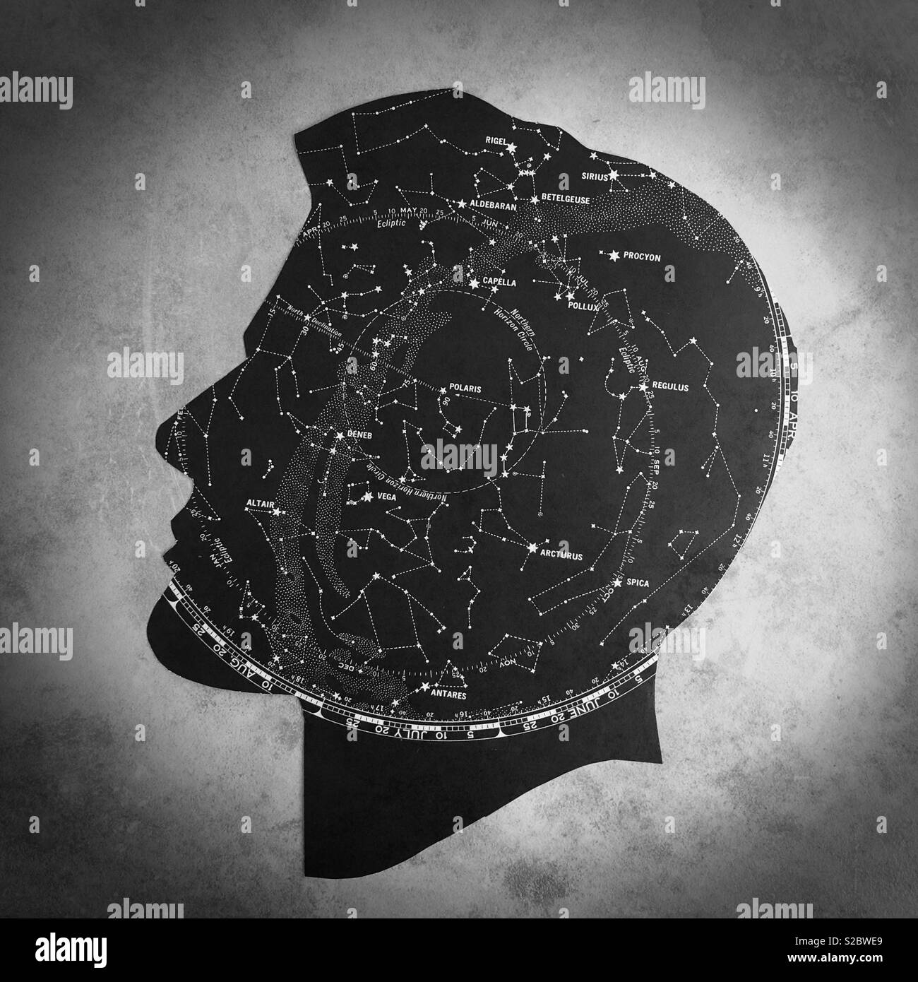 Conceptual: astronomy, from cut paper. - Stock Image