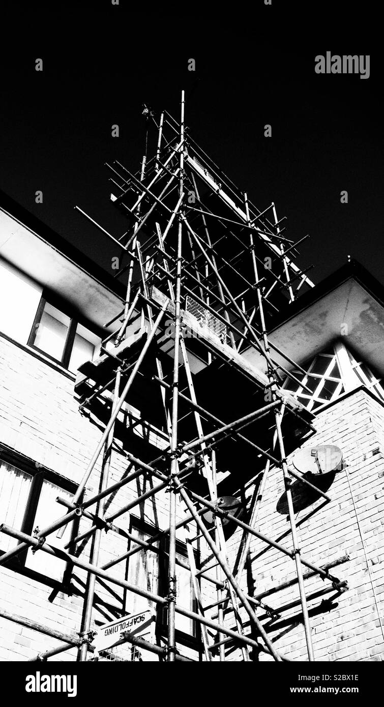 Scaffolding 'web' on the side of a building - Stock Image