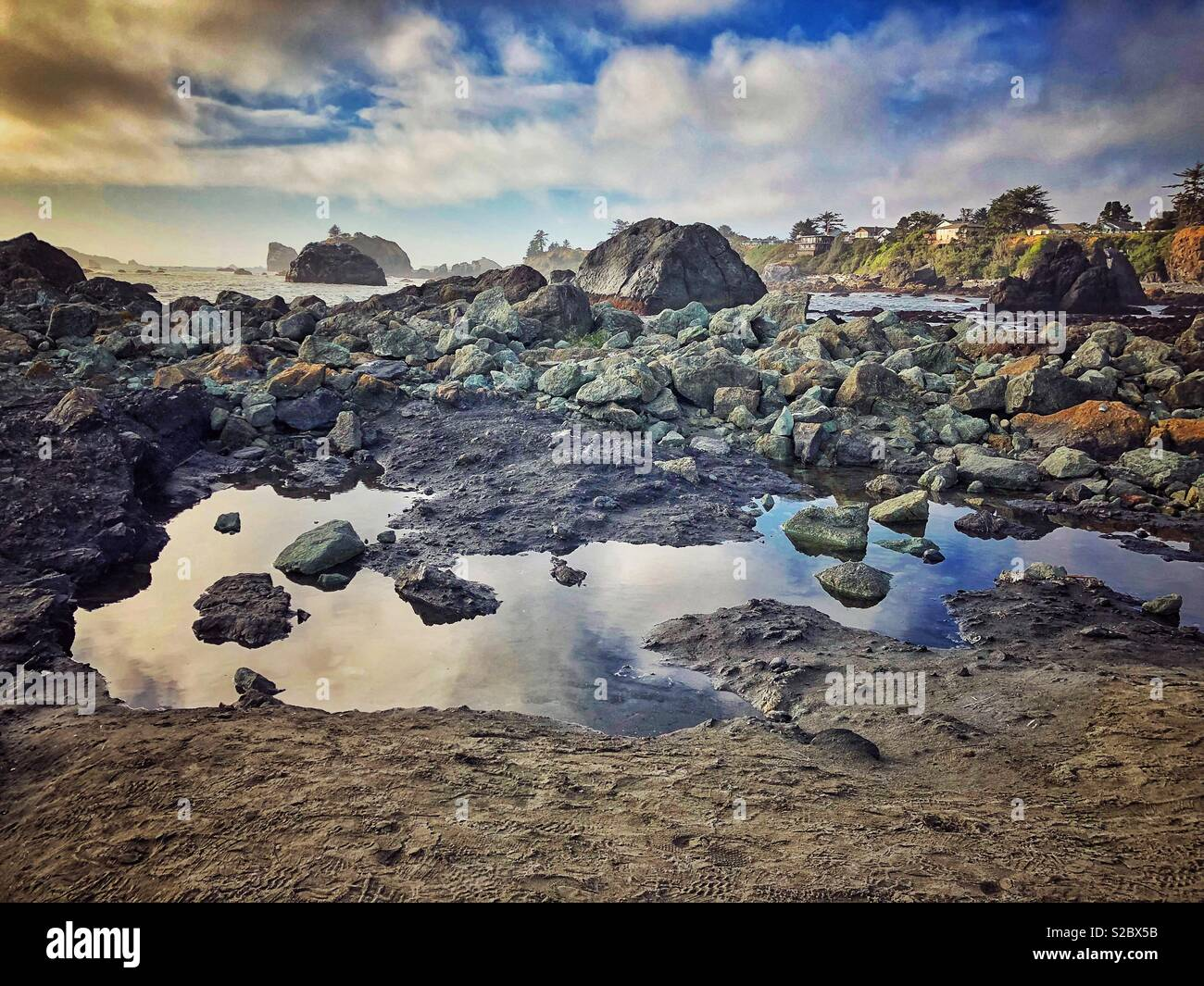Tide pools along the rocky shore. - Stock Image