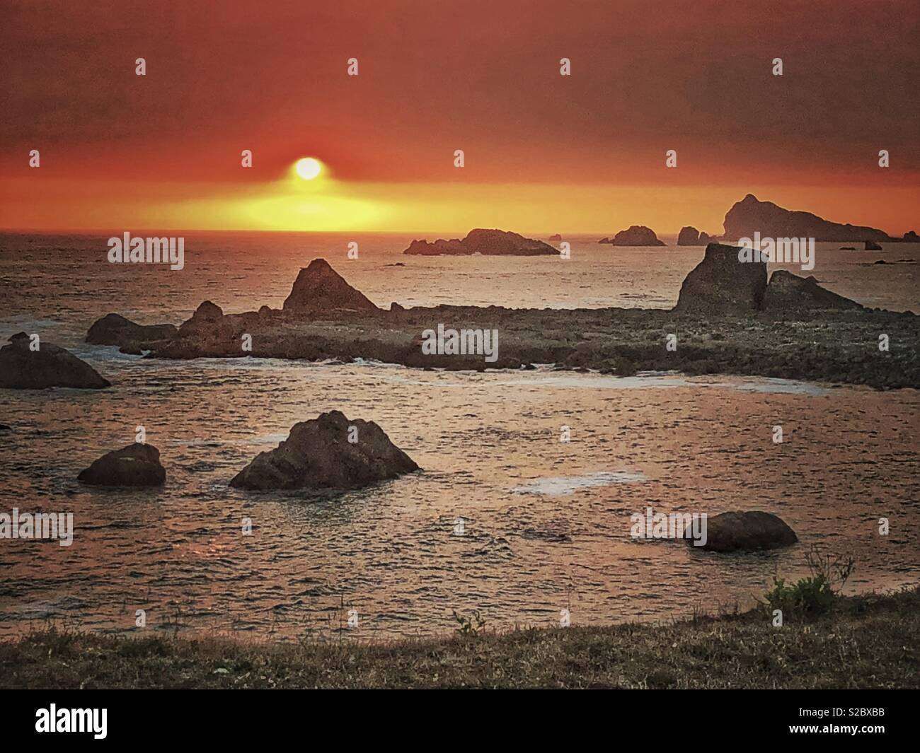 Sunset over the pacific. - Stock Image