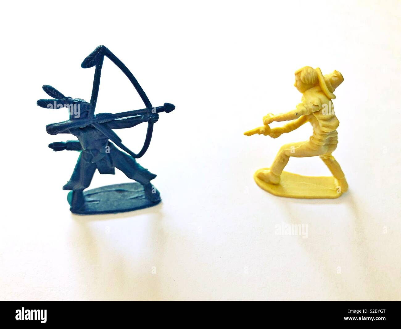 Plastic cowboy and Indian toys at war. - Stock Image