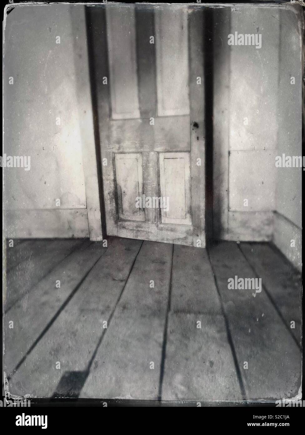 Door ajar in old house. - Stock Image