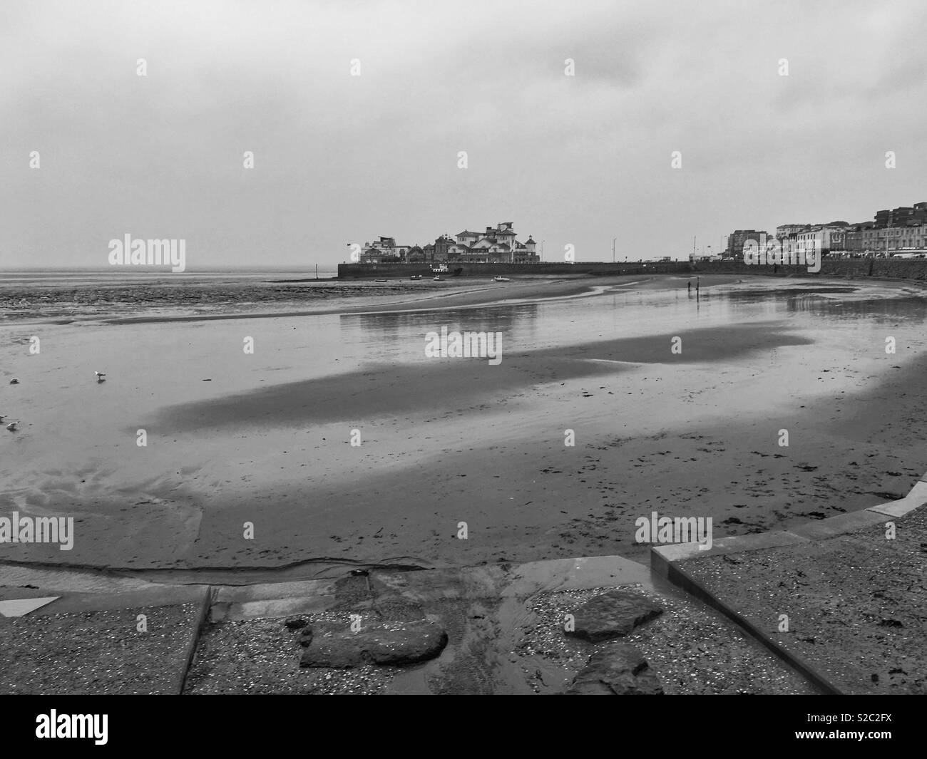 A wet, windy, and gloomy day in Weston-super-Mare, UK as the edge of Storm Callum passes over the town - Stock Image