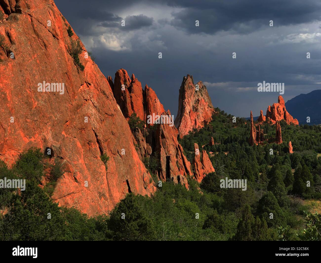 Taken right before it rained, the sky had a perfect color for a nice stormy sky pic. Rocks had a beautiful red tint to them. - Stock Image