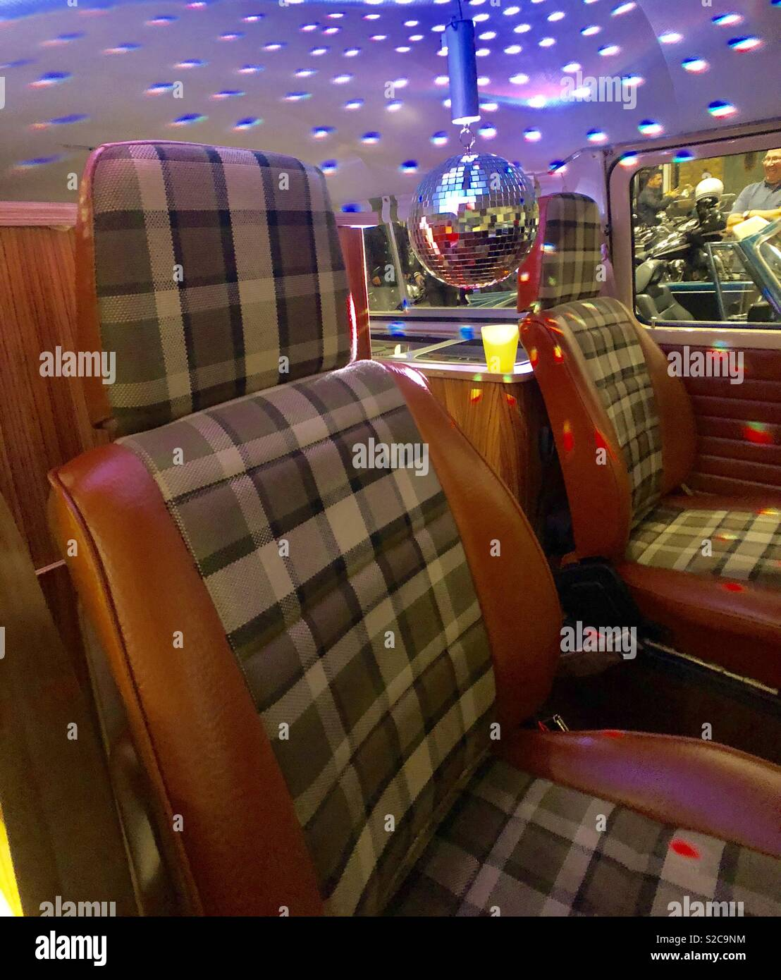 Interior of VW van at car meet in Greenwich London shows disco ball plaid interior - Stock Image