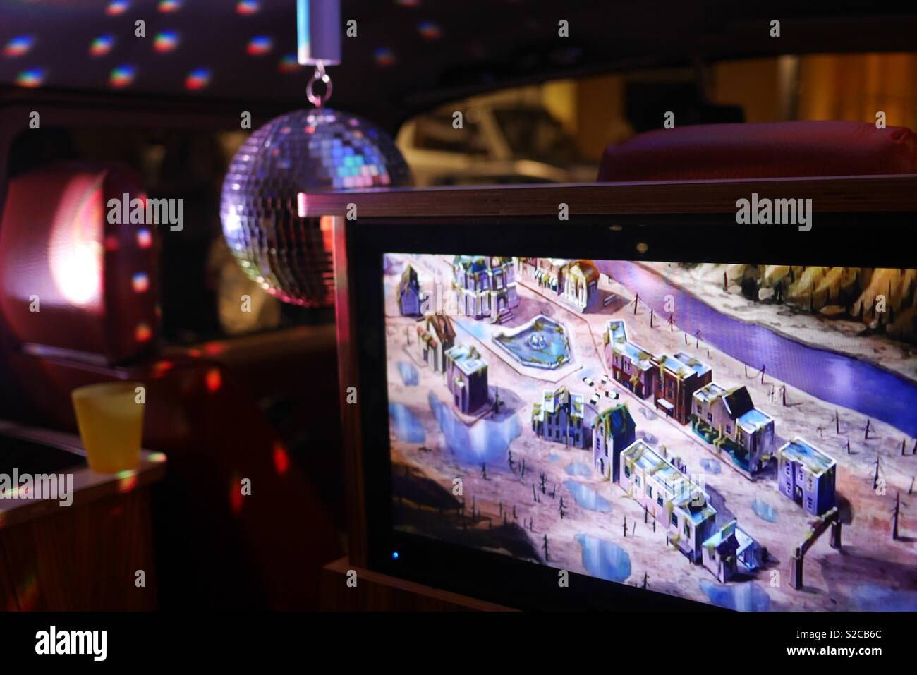 Vw van interior with tv screen dvd and disco ball at Greenwich Market car event - Stock Image