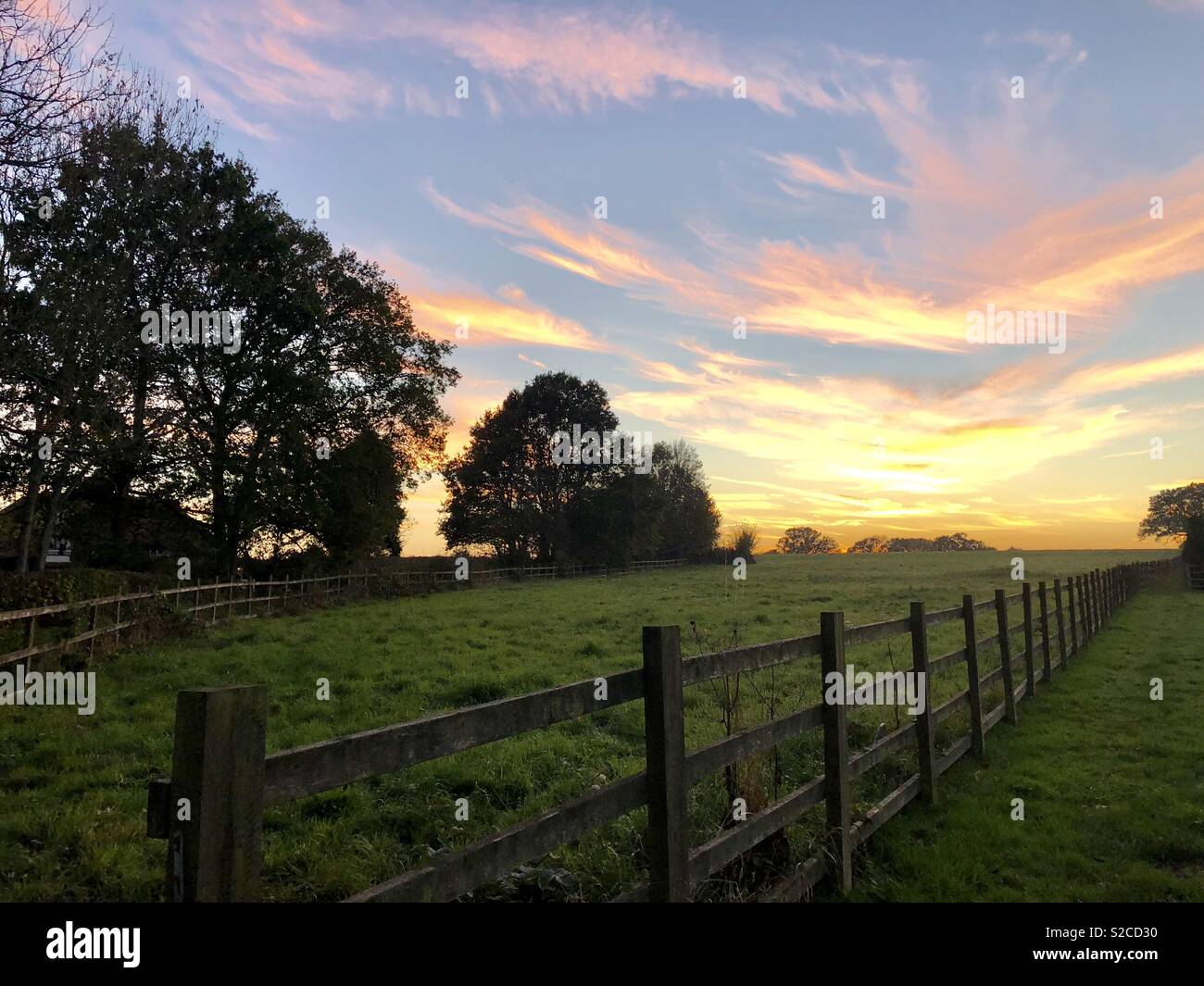 Sunset over farm lands. - Stock Image