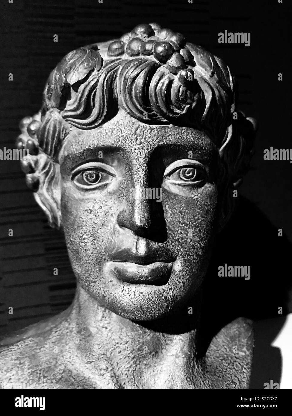 Sculpted Face Of Dionysus The Greek God Of Wine Harvesting And Wine Making Stock Photo Alamy