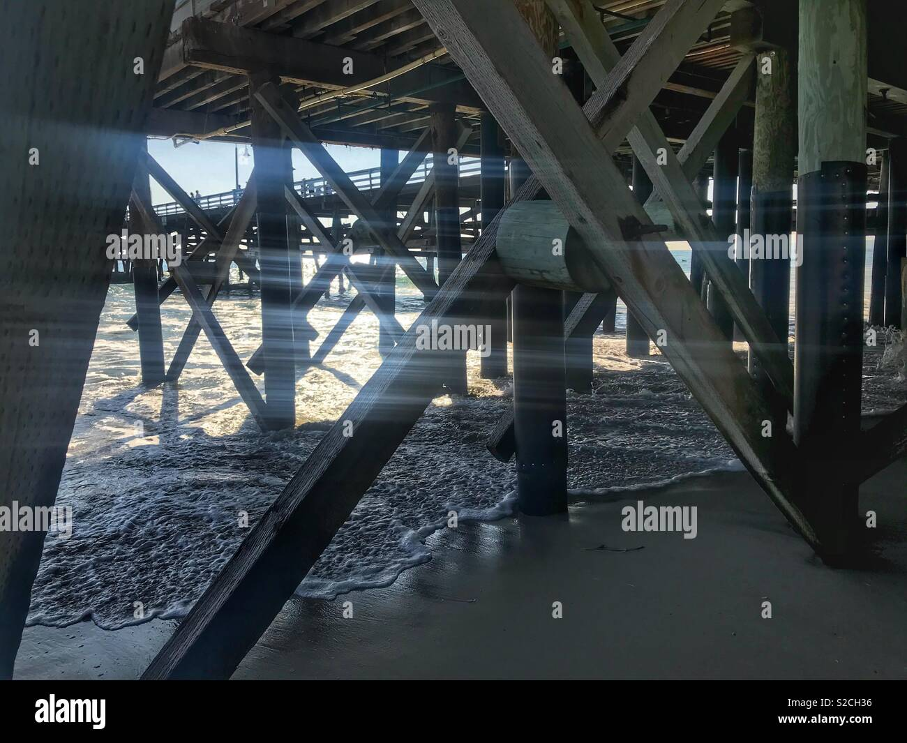 Light through the pier. Stock Photo